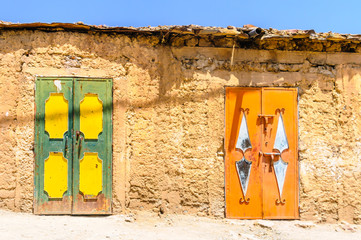 two colourful doors on a building in morocco
