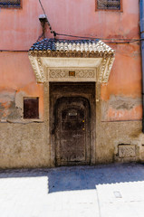 Traditional wooden door and canopy in the Medina in Marrakech, Morocco