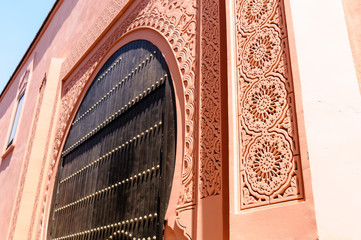 intricate plaster carvings around an archway in the medina in marrakech morocco