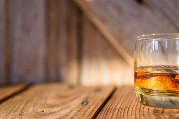 single glass of bourbon on the rocks