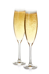 Two glasses of champagne with foam and bubbles on white