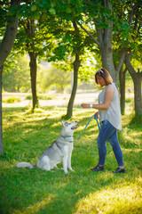 Girl Training the dog husky