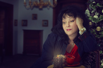 Mature woman feels frustrated at Christmas