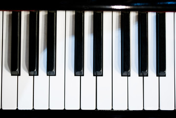 piano keyboard black and white theme top view with dark vignette
