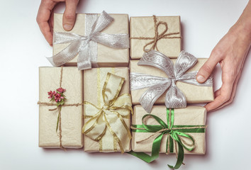 Hands hold boxes with gifts. The concept of a holiday.