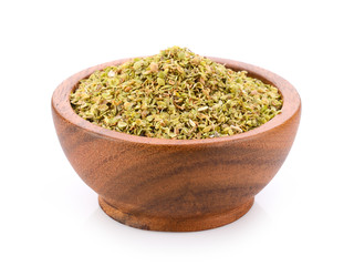 Oregano spice in wood bowl on white background