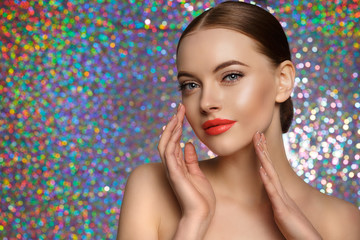 Young Beauty Woman touch own face. Fresh clean fresh glowing Skin. Beautiful girl with perfect makeup, bright manicure. Cosmetology and Facial Treatment, spa.