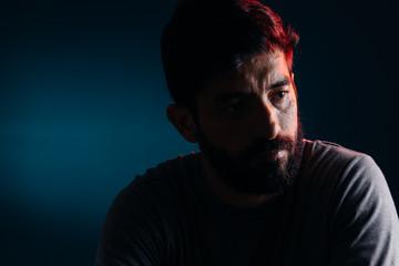 Dramatic portrait of bearded man. Concept of sadness, depression, alert