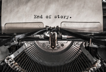 close up image of a vintage old typewriter with a paper sheet and the phrase: end of story.