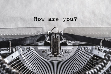 How are you? Printed on an old vintage typewriter. Close-up.