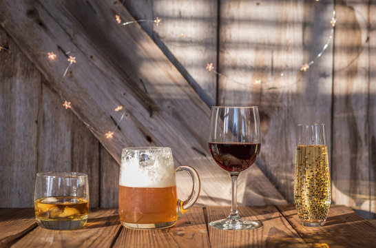 alcoholic drinks on old weathered wood background