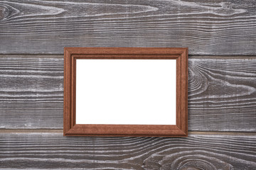 Frame isolated white chalkboard on wooden background. Mock up.