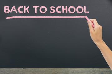 """""""Back to school"""" written by pink chalk on the black school chalkboard"""