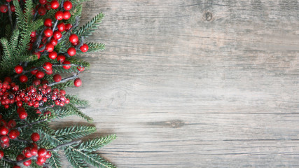 Holiday Evergreen Branches and Berries Over Rustic Wood Background Wall mural