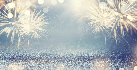 Fototapete - Gold and blue Vintage Fireworks and bokeh in New Year eve and copy space. Abstract background holiday.
