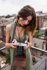 Urban roof photoshoot woman walk concept. Photographer lifestyle. Working process. Photo revise.