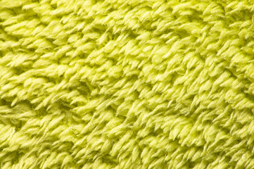 Green plush or wool texture