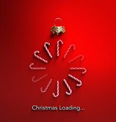 Christmas Loading - Candy Canes In Bauble Shape And Downloading