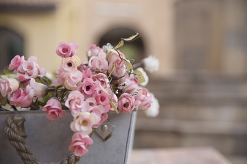Artificial flower with bright pots