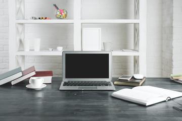 Modern office desktop with empty laptop screen