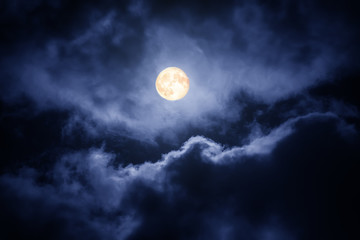The moon on the dark sky among the clouds, natural abstract background Fotoväggar