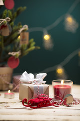 Classic Christmas Composition. Box with Candles, Balls, Toys, Pine Cones, Walnuts on Wooden Background