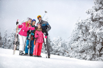 Happy woman with family making  selfie in mountain