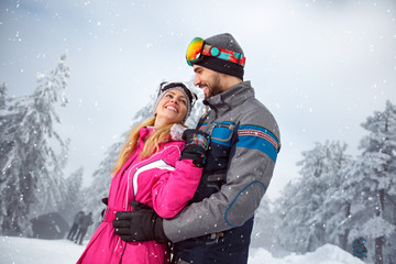 Couple in love on snowy nature together