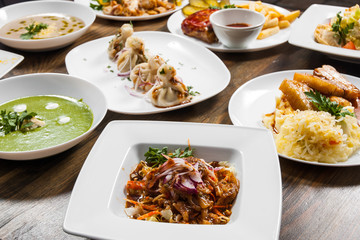 dishes with different food on the wooden table.