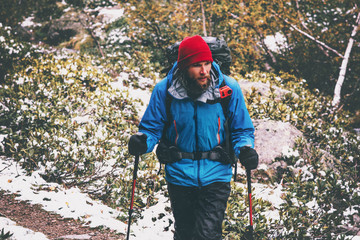 Bearded Man Traveler hiking alone in forest with action camera on backpack Travel Lifestyle adventure survival concept outdoor active vacations