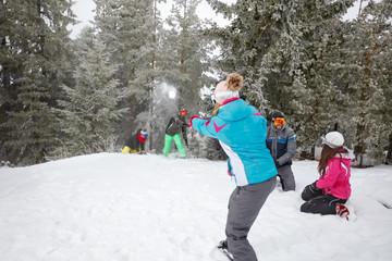 Family snowballing on mountain