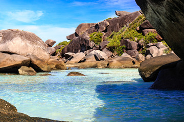 Turqouise water and a granite coastline on a tropical island