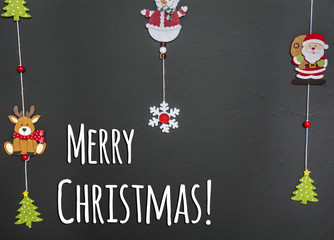 Christmas Black Background with Hanging Ornaments and Merry Christmas Text