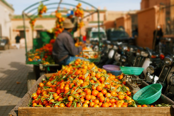 traditional morocco fruits oranges in street shop souk