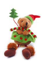Christmas bear decoration. Cute plush toy decor for christmas. Mini Teddy bear wearing christmas costume. Winter holiday isolated white photo. Christmas concept.
