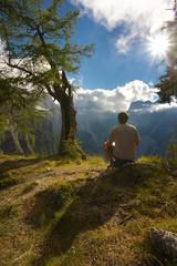 Resting man watching a mountain landscape, Triglav National Park, Slovenia