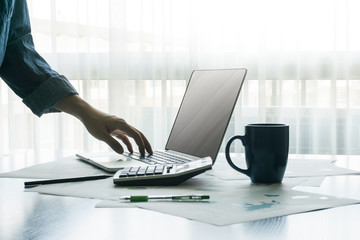 businessman typing on notebook keyboard. finances and business concept