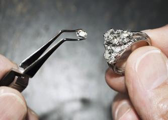 diamond in tweezers with ring