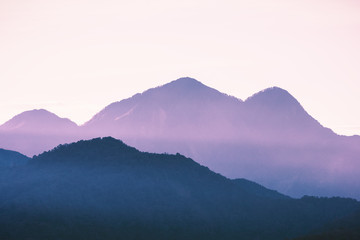 Mountain peaks touching light after sunset turned to sweet purple color at Sun Moon Lake, Nantou of Taiwan.