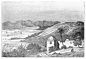 Overall ancient view of Algiers bay with arabian building in foreground, hills, little town and Mediterranean Sea in background. By unidentified author published on Magasin Pittoresque Paris 1834