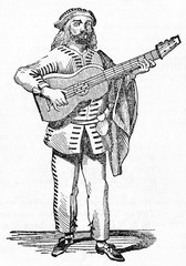 Brighella ancient comic masked character from the Italian Commedia dell'arte playing a guitar on stage. Old Illustration by unidentified author publ. on Magasin Pittoresque Paris 1834