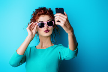 woman making selfie