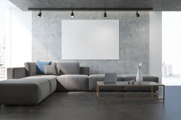 Concrete living room armchair and poster