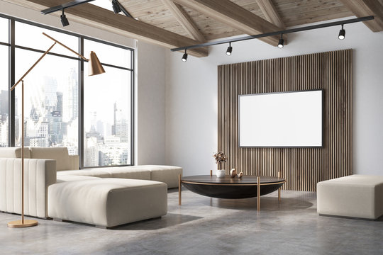 White and wooden living room corner, poster, sofa