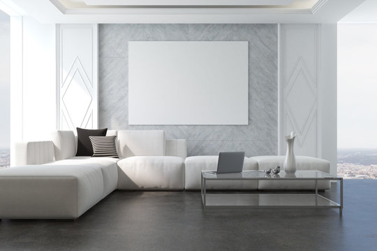 Gray living room armchair and poster