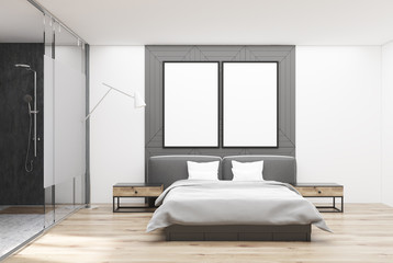 White and gray bedroom, posters