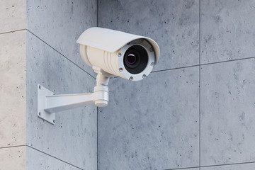 White CCTV camera on a gray wall