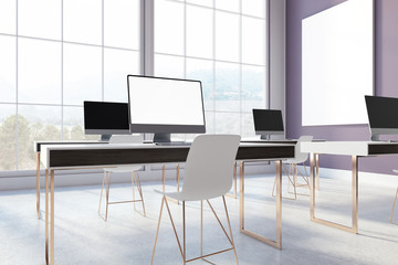 Purple office with blank screen computers