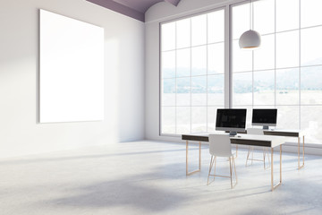 White office with blank screen computers