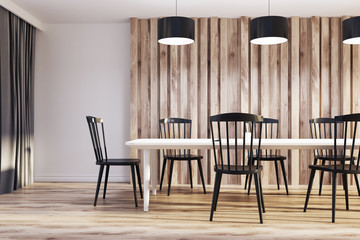 White and wooden dining room, black chairs